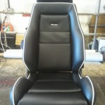 Recaro Seat in Classic Black Carbon Fibre and White Piping